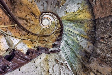 old abandomend rotting spiral staircase with railing