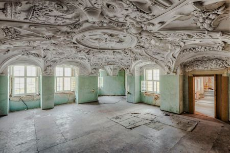 abandoned room with baroque ceiling